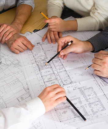 Team discussing project floor plans